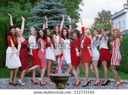 Hen party: bridesmaid in white and red - stock photo