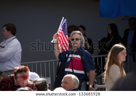 HENDERSON, NV - OCTOBER 23: Supporter with flag for Governor Mitt Romney on a Presidential Campaign rally on October 23, 2012 at Henderson Pavilion in Henderson, NV - stock photo