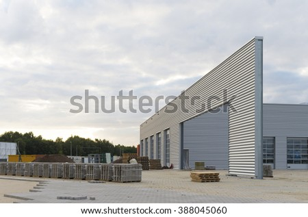 HENGELO, NETHERLANDS - AUGUST 19, 2015: Construction site with unfinished industrial warehouse in evening light