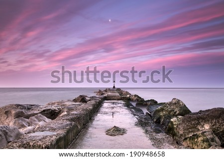 Hengistbury head groyne sunrise long exposure, Christchurch, Dorset, England, UK - stock photo