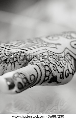 Henna is applied to the hands of a Hindu Bride - stock photo