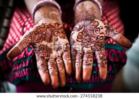 Henna on an unidentified womans hand in Rajasthan, India  - stock photo