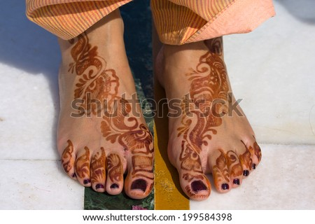 Henna on feet of bride from India - stock photo