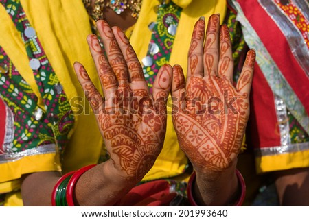 Henna on hands of bride from India - stock photo