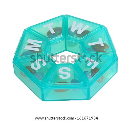 Heptagonal dispenser for a week of pills isolated against a white background - stock photo