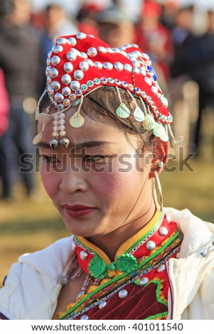Heqing, China - March 15, 2016: Chinese woman in ancient Chinese clothing during the Heqing Qifeng Pear Flower festival