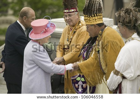 Her Majesty Queen Elizabeth II and Prince Philip meeting Powhatan Tribal Member in front of Virginia State Capitol, Virginia as part of the 400th anniversary of the Jamestown Settlement, May 3, 2007 - stock photo