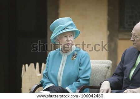 Her Majesty Queen Elizabeth II and Vice President Dick Cheney observing ceremony at James Fort, Jamestown Settlement, Virginia on May 4, 2007. - stock photo