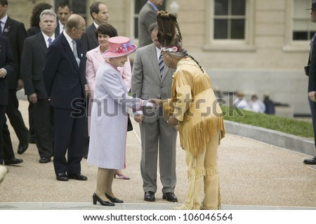 Her Majesty Queen Elizabeth II, Prince Philip and Virginia Governor Timothy M. Kaine meeting Powhatan Tribal Member in front of Virginia State Capitol, Richmond Virginia, May 3, 2007 - stock photo
