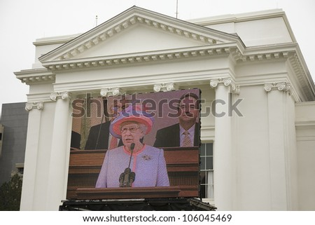 Her Majesty Queen Elizabeth II speaking on a large television monitor to the Virginia State Assembly, at the Virginia State Capitol in Richmond Virginia, May 3, 2007