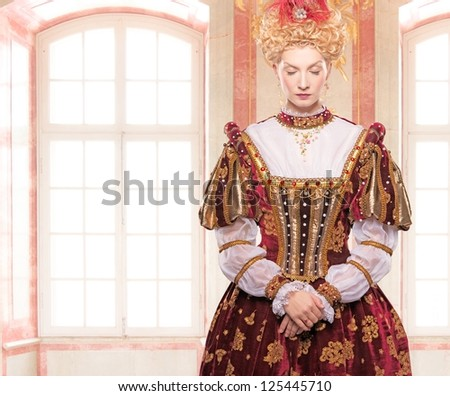 Her royal highness standing against window - stock photo