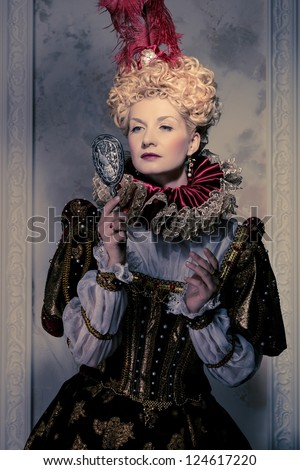 Her royal majesty with mirror - stock photo