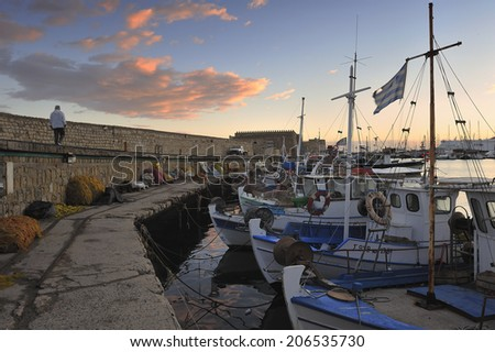 Heraklion, capital of Crete island in Greece. Old town and harbor is surrounded by the old Venetian construction such as Koules Fortress - stock photo