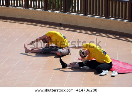 HERAKLION, CRETE ISLAND, GREECE - MAY 05, 2010: Two girls exercise in the open air - stock photo