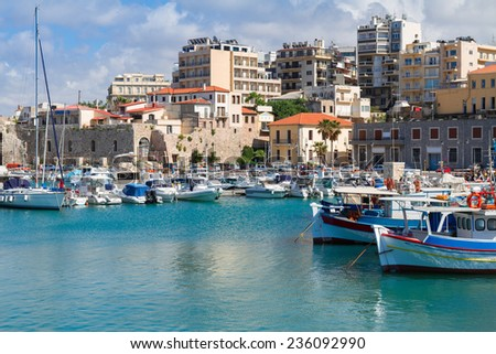 Heraklion old town port with colorful boats, at sunny day, Crete, Greece - stock photo