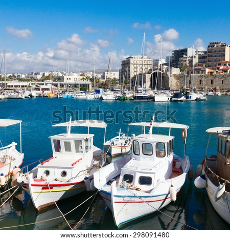 Heraklion old venetian harbour with colorful boats, Crete, Greece - stock photo