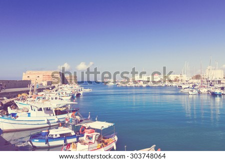 Heraklion old venetian harbour with colorful small boats, Crete, Greece, retro toned - stock photo