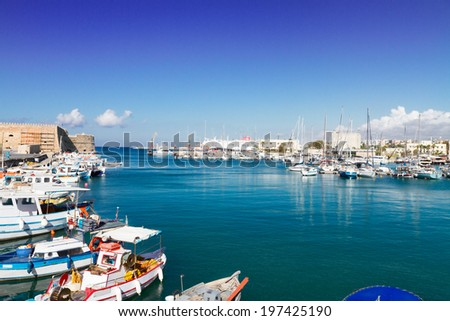 Heraklion old venetian port with colorful boats, Crete, Greece - stock photo
