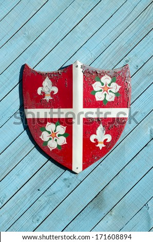 heraldic shield on wooden background - stock photo