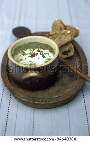 Herb and egg soup - stock photo