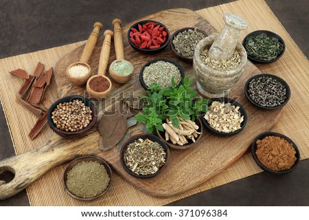 Herb and spice health food selection for men in wooden bowls and spoons. Used in natural alternative herbal medicine. - stock photo