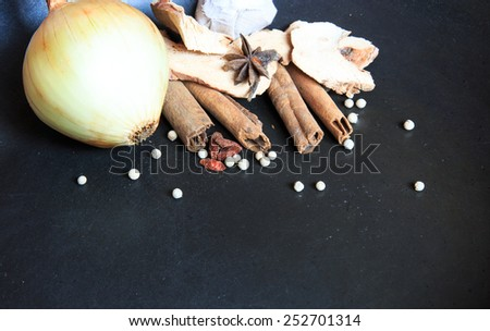 Herb and spices on black background, dry food - stock photo