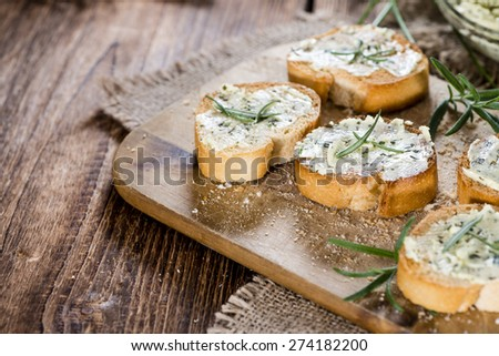 Herb Butter Baguette (detailed close-up shot) on wooden background - stock photo