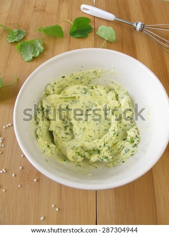Herb butter in bowl - stock photo