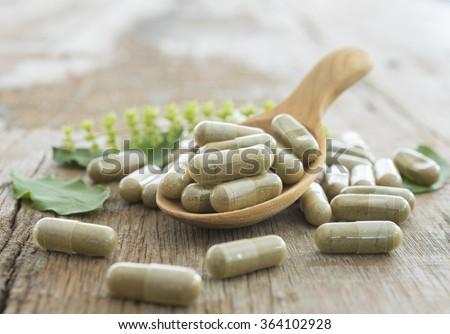 Herb capsule, Nutritional Supplement, Vitamin Pill, Herbal Medicine. - stock photo