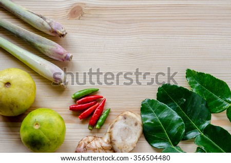 Herb ingredient of Tom Yum spicy soup Thai food cuisine on wooden background - stock photo