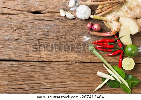 Herb ingredient of Tom Yum spicy soup  Traditional Thai food cuisine on wood background - stock photo