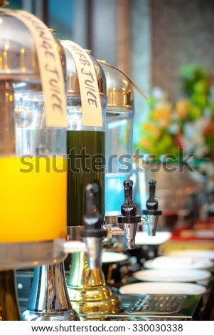 Herb juice, Orange juice and water in water cooler for guess of seminar in the hotel - stock photo
