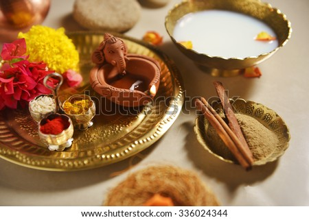 Herbal and Ayurvedic bath ritual during special and spiritual occasion. A holy hindu ritual in India. - stock photo