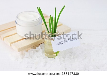 Herbal and mineral skincare. jar of white cream, oil with wheat  grass, sea salt. Handwritten label   - stock photo