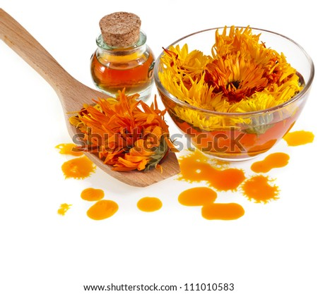 herbal calendula in the glass and drop oil Isolated white background