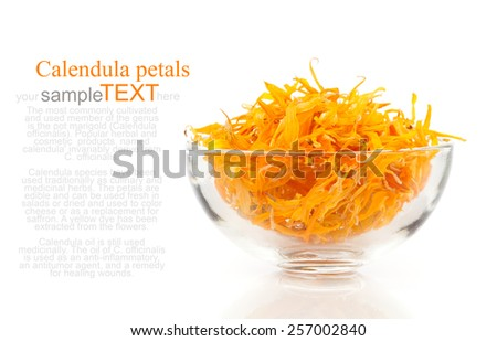 herbal calendula in the glass bowl, isolated white background - stock photo