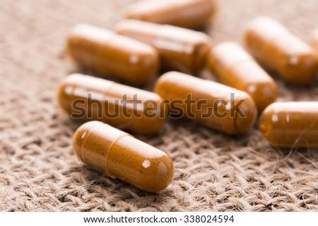 Herbal capsule. Alternative medical care. - stock photo