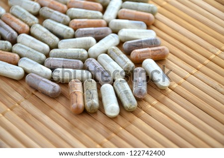 herbal capsules - stock photo