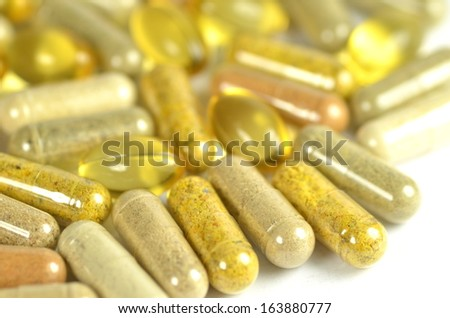 herbal capsules and fish oil capsules isolated on white background