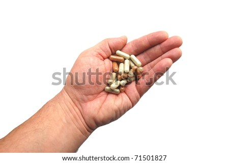 Herbal capsules on a hand - stock photo