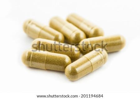 Herbal capsules on white  - stock photo
