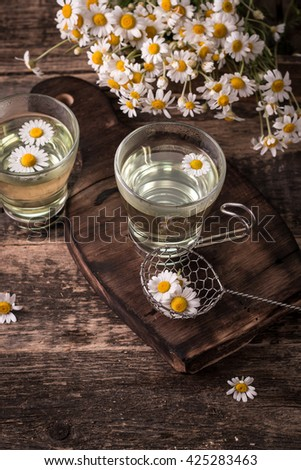 herbal chamomile tea on a wooden table.