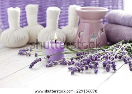 herbal compress balls for spa treatment and lavender - beauty treatment - stock photo