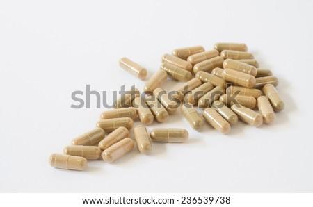 Herbal drug, alternative medicine in capsule - stock photo