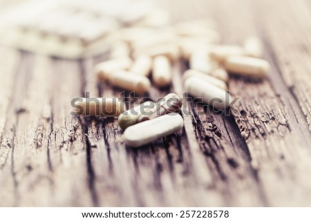 Herbal Drug . an alternative medicine in capsule. - stock photo