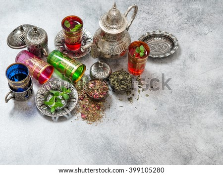 Herbal green tea with mint leaves. Oriental silver table dishes - stock photo