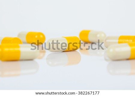 Herbal in capsules on white background