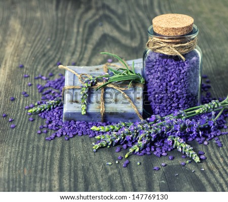 herbal lavender soap and  bath salt with fresh flowers over grunge wooden background - stock photo