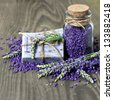 herbal lavender soap and  bath salt with fresh flowers over wooden background - stock photo