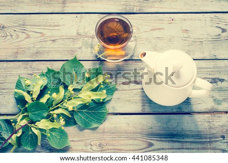 Herbal linden tea/toned photo - stock photo